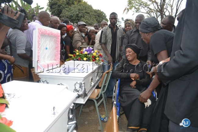 LATE CBU student Francis Mulenga's mother on a wheelchair breaks down  during body viewing at the grave yard