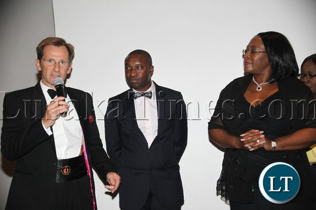 First Quantum Minerals Ltd Zambia government Affairs John Gladston (l) talks as the First Lady Dr. Christine Kaseba (r) and Maysen and Borowski Group Manager Charles Kamwi listen during the Dinner Reception for UTH in partnership with Health Hope for Zambia at Intercontinental in Lusaka