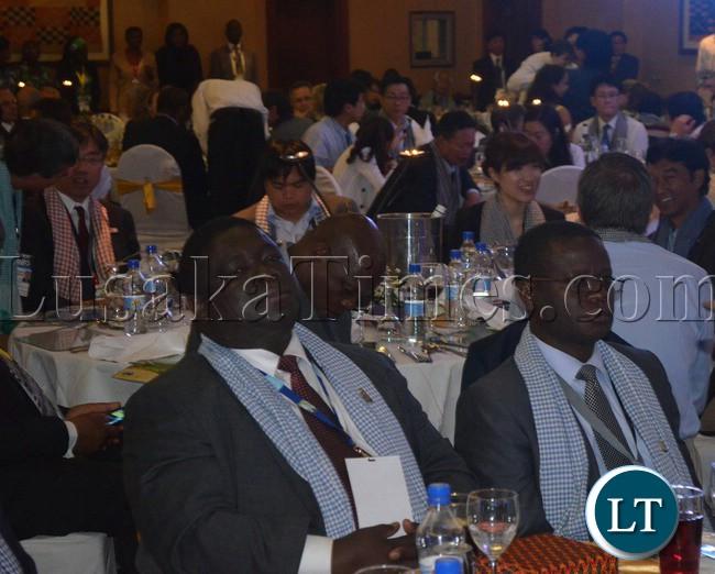 Transport Minister Yamfwa Mukanga (left) and his Permanent Secretary Bernard Chiwala (right) at Elephant Hills Resort in Zimbabwe on Monday during a Cambodia Night.