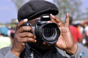 FILE: Human Rights activist Brebner Changala takes photographs at the UPND Mandevu Rally.