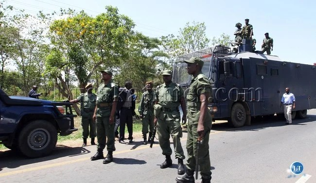 Zambia Police in Riot gear on Airport Road during the laying of the foundation stone by PResident Sata at the Kenneth Kaunda International airport