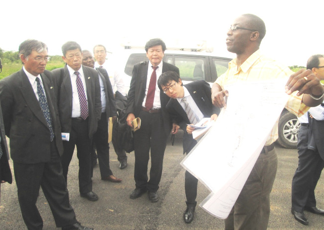 LUSAKA South Multi-Facility Economic Zone (MFEZ) chief surveyor Christopher Sinyangwe addresses the Japanese Investment and Trade mission delegation which included Japanese Ambassador to Zambia Kiyoshi Koinuma and Japanese Chamber of Commerce and Industries in South Africa vice chairman Hiroshi Okado during the conducted tour of the MFEZ last week.