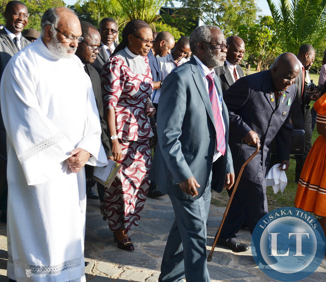 First Republican President Kenneth Kaunda (far right) leaves Cathedral of the Holy Cross in the company of Labour Minister Fackson Shamenda, Council of Churches in Zambia General Secretary Susana Matale and Cathedral of the Holy Cross Minister in Charge Father Charley Thomas (left) in Lusaka