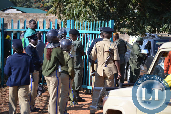 Police man the entrance to keep rival cadres from the ruling Patriotic Front and the opposition UPND from clashing at the magistrate's court complex where opposition UPND leader Hakainde Hichilema was attending a court case in Lusaka