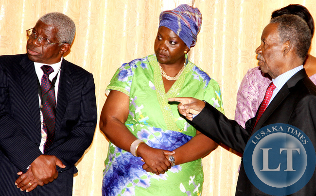 FILE:  Anne Sinyangwe  (C) and State House Principal Private Secretary  Francis Chalabesa shortly before the swearing-in-ceremony at Zambia's Ambassador to Russia Solomon Mbuzi at State House on 6th June 2014