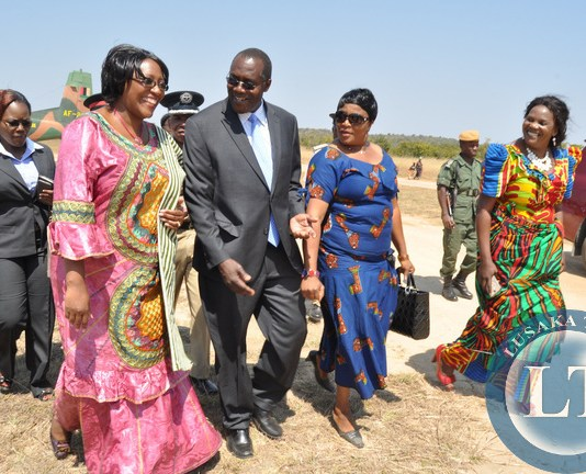 First Lady Dr Christine Kaseba flanked by Muchinga Province Permanent Secretary Bwalya Ng'andu , Chinsali District Commissioner Evaline Kangwa (r) and Mpika District Commissioner Catherine Chileshe on arrival at Chinsali Airstrip for the Teachers/ Community Leaders / Pupils Mentorship Training programme on August