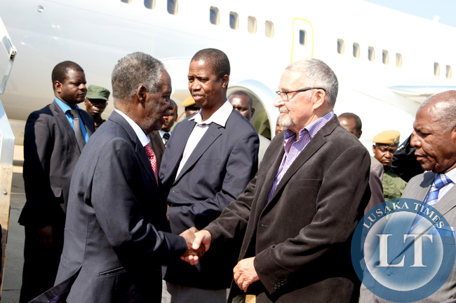 President Sata being welcomed by Vice-President Dr Guy Scott on arrival at Kenneth Kaunda International Airport from New York on sepember 28,2014 -Picture by THOMAS NSAMA