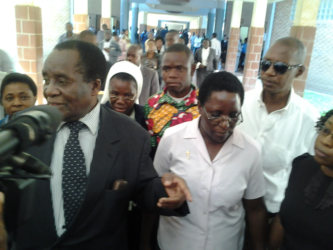 Sister Chakupalesa being escorted outside court