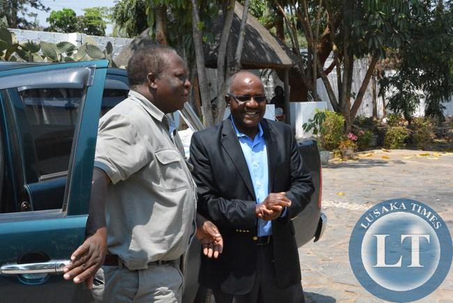 Former Zambian Ambassador to Russia John Sikaulu greets former republican vice president Enock Kavindele