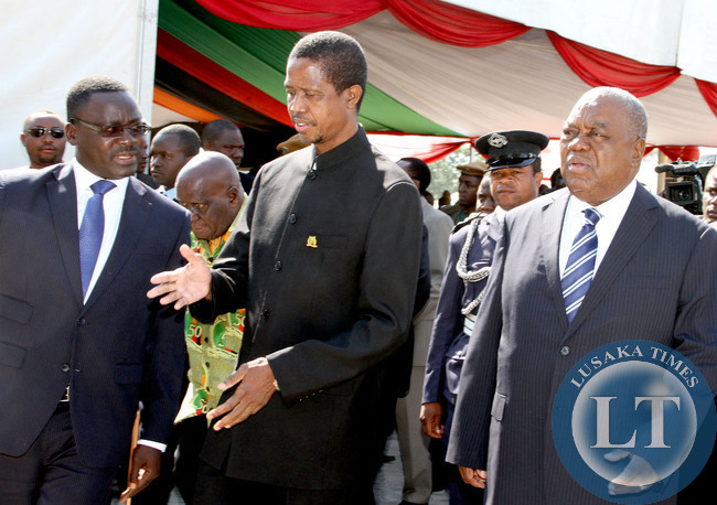 Acting President Edgar Lungu with former president Rupiah Banda (r) and acting Chief of Protocol Humphrey  Chibanda (l)  on arrival at Freedom Statue during the Golden Jubilee celebrations in Lusaka on October 24,2014  -Picture by THOMAS NSAMA