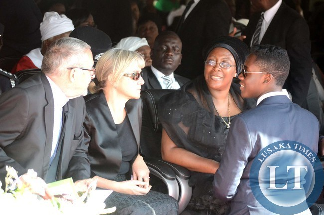 FIRST LADY Christine Kaseba Sata shares a light moment with her son Gerard as acting President Guy Scott and his wife Charlotte looks on