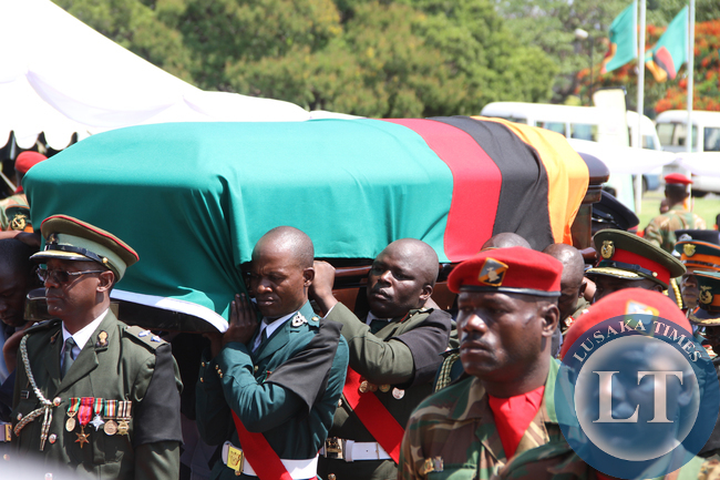 Defence force personnel carrying a casket on arrival at Parliament for the Interdenominational Thanks giving requiem church service of President Sata on November 10,2014 -Picture by THOMAS NSAMA