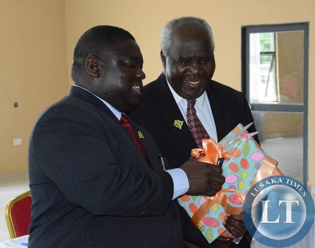 Transport and Communication Minister Yafya Mukanga cuts the Ribbon to officially launch Road Maintenance Strategy 2015-2024 whilst his Deputy Minister Panji Kaunda looks on
