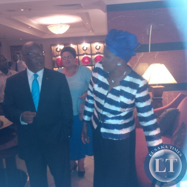 Dr Nevers Mumba consulting with Ms Nawakwi before leaving  the hotel