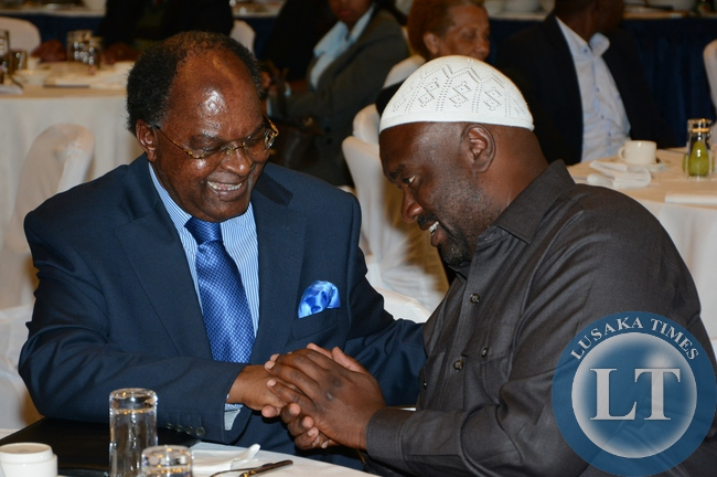 Bank of Zambia Governor Michael Gondwe having the light moment with Islamic Supreme Council President Suzgo Zimba during the launch of Islamic Finance guideline