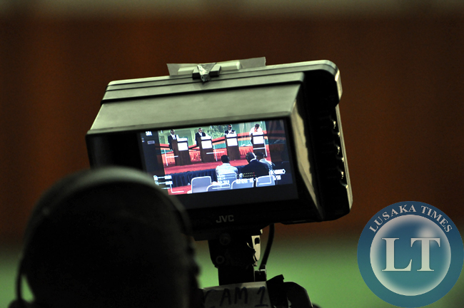 A MUVI TV studio camera beams lives footage of the presidential debate from the Mulungushi International Conference Centre