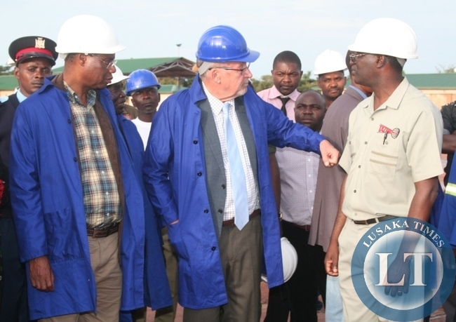 Acting President  Guy Scott being shown newly constructed government fuel tankers by Tazama pipeline managing director Davison Thawethe (r ) during the tour of the facility as Local government minister Emmanuel Chenda (l ) looks on.