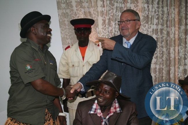 Acting President Guy Scott being greeted by chief Mumena (l) during the meeting with Solwezi based traditional leaders at Solwezi Lodge on Thursday in Solwezi