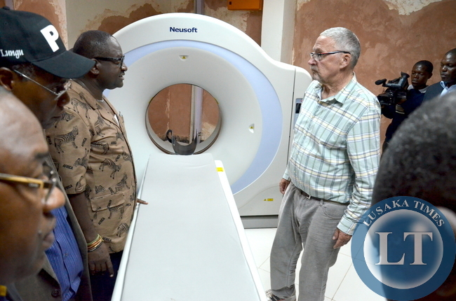 Acting President Dr. Guy Scott having a feel of the new CT scanner at ndola central hospital