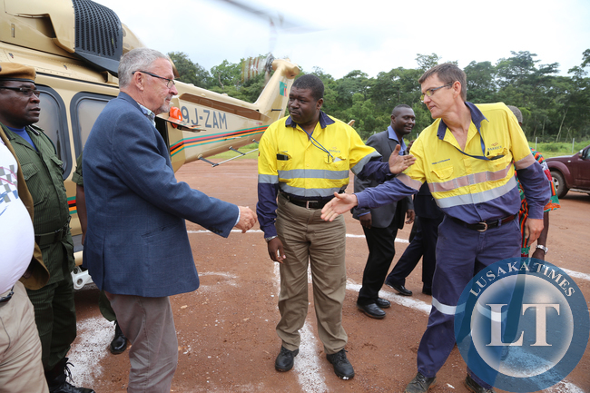 Dr Guy Scott at Lumwana Mine greets Mr Bill MacNevin General Manager and Mr Nathan Chishimba Corporate Manager Lumwana mine in Solwezi on Saturday Picture By Eddie Mwanaleza.