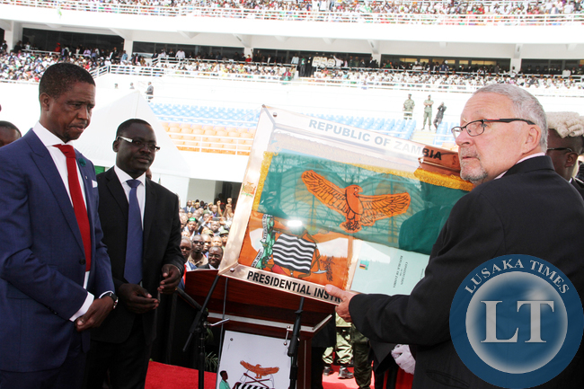 Former Acting President Dr Guy Scott handing over the instruments of Power to President Edgar Lungu during the Inauguration Ceremony at Heroes Stadium in Lusaka on January 25,2015 -Picture by THOMAS NSAMA