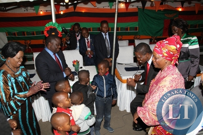 President Edgar Lungu and First Lady Esther interacts with children of the zambian community living in Addis Ababa, Ethiopia on the sidelines of the 24th ordinary session of the African Union summit. On the left is Zambia's Ambassador to Ethiopia Susan Sikaneta and Foreign Affairs Minister Harry Kalaba.