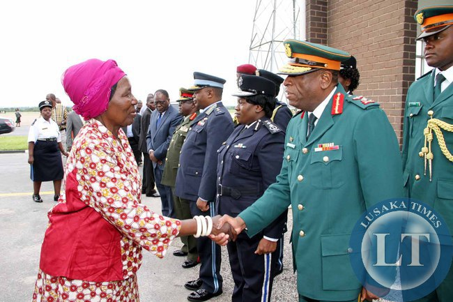 Acting President Inonge Wina greets service Chiefs shortly before seeing- off President Lungu  at Kenneth Kaunda International Airport who left for  Addis Ababa, Ethiopia for the African Union Summit on January 29,2015 -Picture by THOMAS NSAMA