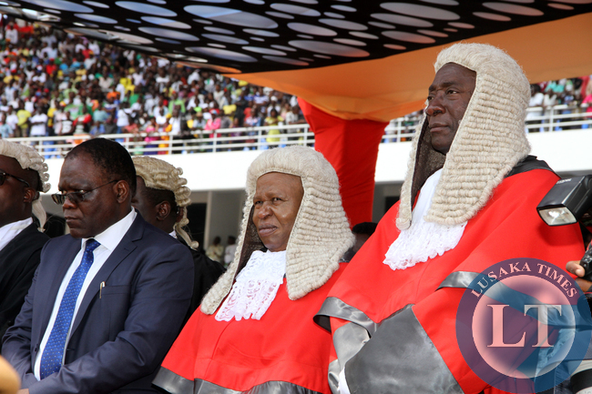 Secretary to the Cabinet Dr Msiska with the Acting Chief Justice Lombe Chibesakunda and Justice Mwanamwambwa during the Inauguration Ceremony of President Edgar Lungu at Heroes Stadium on January 25,2015 -Picture by THOMAS NSAMA