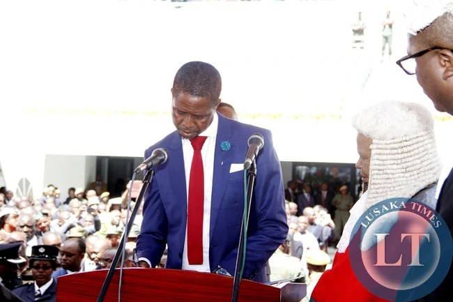 President Edgar Lungu with Acting Chief Justice Lombe Chibesakunda during his Inauguration Ceremony at Heroes Stadium on January 24,2015 -Picture by THOMAS NSAMA