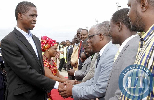 President Edgar Lungu greets Southern Province minister Nathaniel Mubukwanu  on arrival at Kenneth Kaunda International Airport shortly before departure to Addis Ababa, Ethiopia for the African Union Summit on January 29,2015 -Picture by THOMAS NSAMA