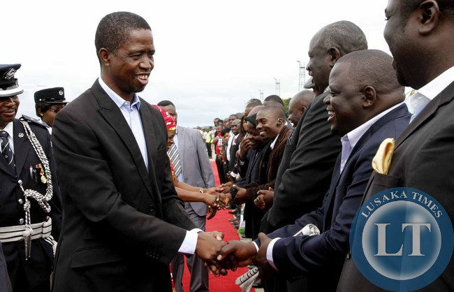 President Edgar Lungu greets PF officials  on arrival at Kenneth Kaunda International Airport shortly before departure to Addis Ababa, Ethiopia for the African Union Summit on January 29,2015 -Picture by THOMAS NSAMA