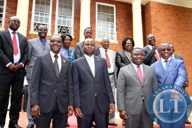 President Edgar Chagwa Lungu with Vice-President Inonge Wina, North Western Province minister, Justice minister Ngosa Simbyakula, Finance minister Alexander Chikwanda, Home affairs Davies Mwila, Tourism minister Jean Kapata , State House Special Assistant to the President for Political affairs Kaiza Zulu, Special Assistand for Press and Public Relations Amos Chanda after the Swearing-in-Ceremony at State House on January 26,2015 -Picture by THOMAS NSAMA