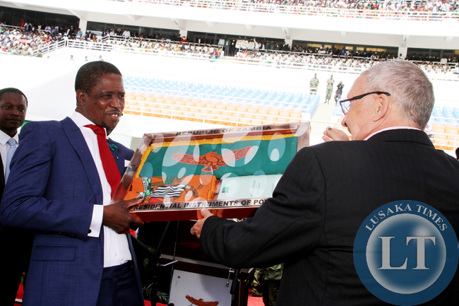 Former Acting President Dr Guy Scott handing over the instruments of Power to President Edgar Lungu during the Inauguration Ceremony at Heroes Stadium in Lusaka on January 24,2015 -Picture by THOMAS NSAMA