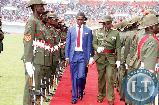 President Edgar Lungu inspects a guard of honour during his Inauguration Ceremony at Heroes Stadium in Lusaka on January 25,2015 -Picture by THOMAS NSAMA