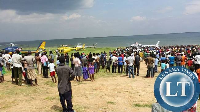 Samfya residents admire PF President Edgar Lungu's Helicopters packed in the fore ground of the lake