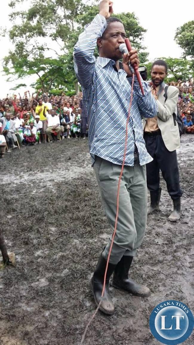 PF President Edgar Lungu seen here wearing gum boots to take time to speak to people in Samfya (Lunga, Bangweulu and Chifunabuli)