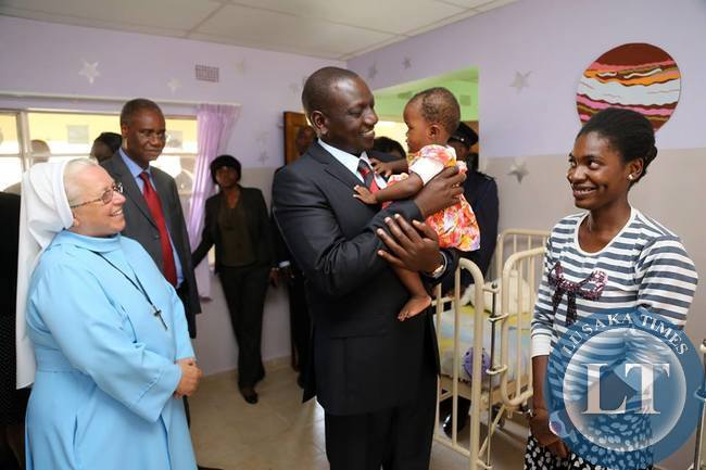 Kenya's Deputy President William Ruto hold one of the child at the orphanage