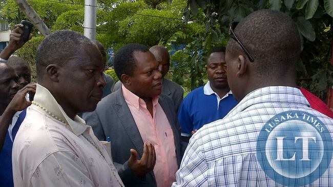 UPND Officials  Banda at the scene of the impounded trucks