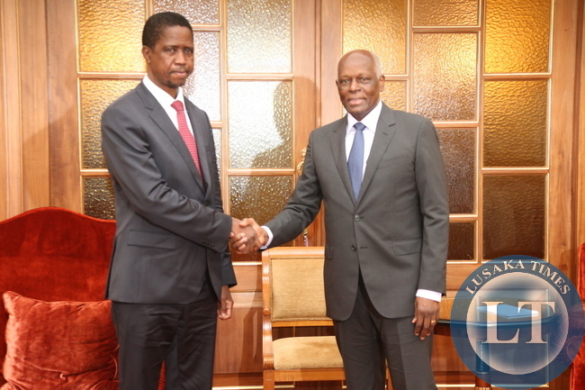 President Edgar Lungu shakes hands with his counterpart President Eduardo Dos Santos at the presidential palace yesterday. Picture by ROYD SIBAJENE/ZANIS