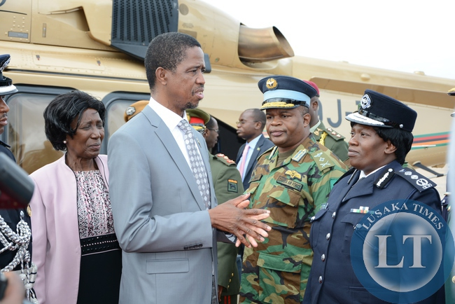 President, Edgar Lungu speaks to  Police Inspector General Of Ms. Stellah Libongani shortly before his departure for South Africa for state visit yesterday