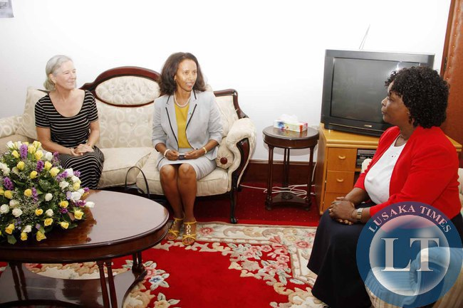 First Lady Esther Lungu  confers with  UNAIDS Investment and Effiency Advisor  Robin Ridley (l) and  UNAIDS Country Director  Medhin Tsehaiu (c) when they visited her at State House on February 18,2015 -Picture by THOMAS NSAMA