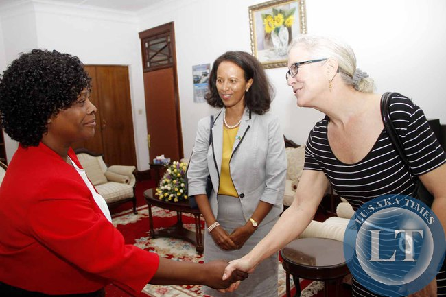 Firs Lady Esther Lungu  greets UNAIDS Investment and Effiency Advisor  Robin Ridley (r) as UNAIDS Country Director  Medhin Tsehaiu (c) looks on when theyvisited her  at State House on February 18,2015 -Picture by THOMAS NSAMA