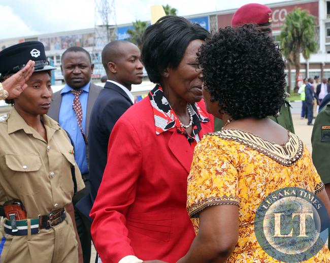First Lady Mrs Ester Lungu greets Vice president Mrs Inonge Wina at KK internatioanal airport she accompanied her Husdand President Lungu/Picture  by EDDIE MWANALEZA/STATEHOUSE.