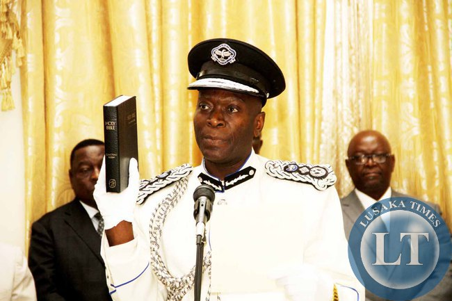 Deputy Inspector General of Police Kakoma Kanganja taking Oath   during the swearing -in-Ceremony at State House on February  3,2015 -Picture by THOMAS NSAMA