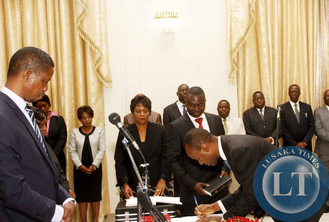 President Edgar Lungu with State House Deputy minister Mulenga Sata during the Swearing-In-Ceremony at State House on February 3,2015 -Picture by THOMAS NSAMA