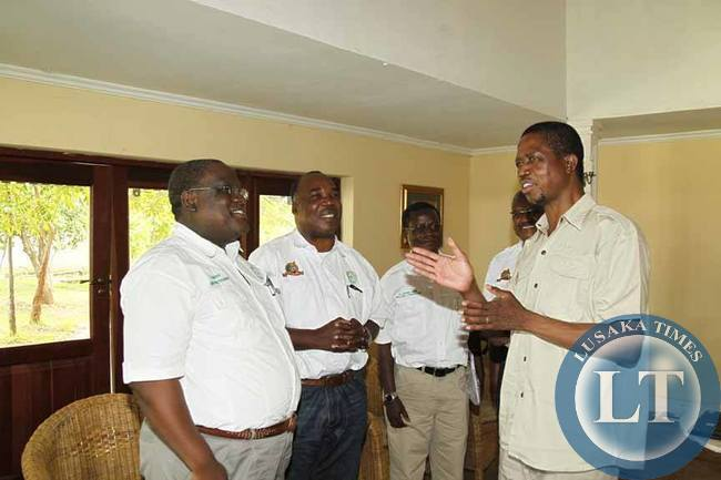 President Edgar Chagwa Lungu (right) talks to George Sitali(left) Prof.Stephen Simukanga(second left),Bernard Chiwala (third left) in Mfuwe on Thursday,February 5,2015. The Engineering Institution of Zambia (E.I.Z) presented a National Transformation Strategy to indutrialise Zambia. PICTURE BY SALIM HENRY/STATE HOUSE