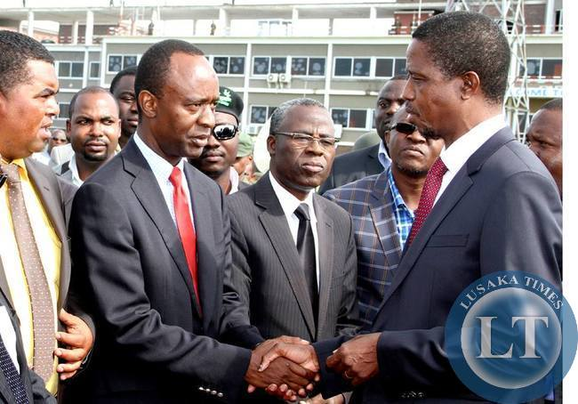 President Lungu greets State House deputy minister Mulenga Sata shortly before departure at Kenneth Kaunda International Airport for Angola on February 13,2015 -Picture by THOMAS NSAMA