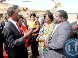 President Lungu talks Information minister Chishimba Kambwili shortly before departure at Kenneth Kaunda International Airport for Angola on February 13,2015 -Picture by THOMAS NSAMA