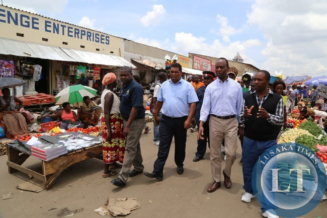 Lusaka Province Minister Obvious Mwaliteta with State house Deputy Minister Mulenga Sata tours the Lusaka city market