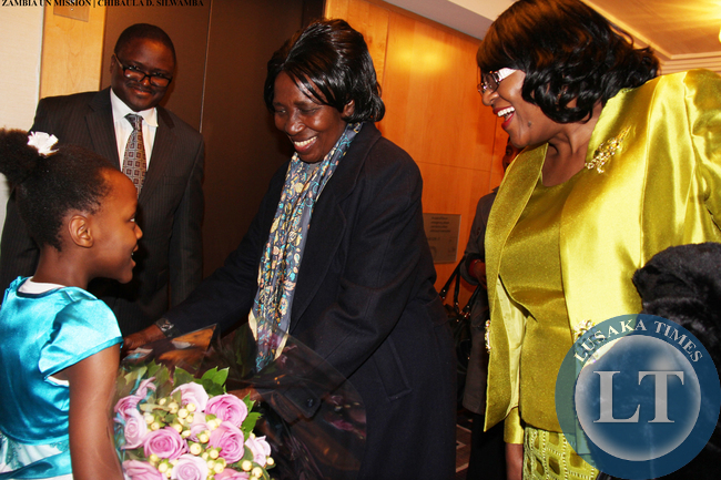 VP Inonge Wina received flowers from eight-year-old Tasheni Bota